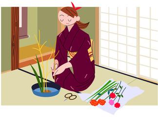 和室で生け花をする女性