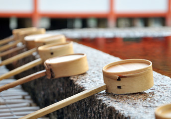 Dipping cups at Itsukushima Shrine (Miyajima Island), japan