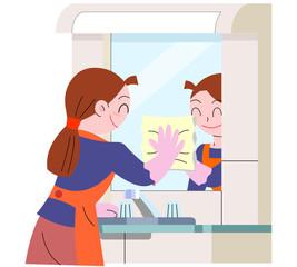 洗面台を清掃する女性