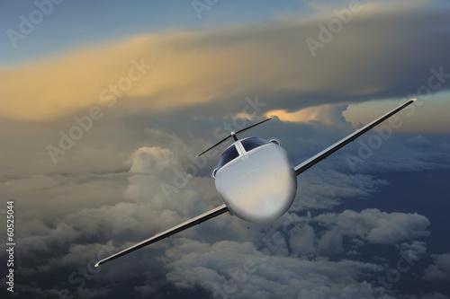 Fototapeta Executive in flight at sunset
