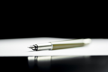 Pen lying on a document