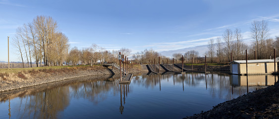 Boat launch pads and steel poles panoramic view OR.