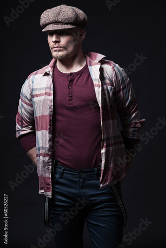 Retro 1900 fashion man wearing brown cap and lumberjack shirt. B