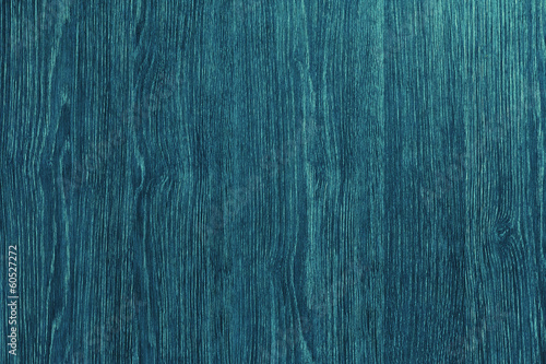 Vintage blue wooden background with sun rays