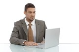 Young businessman using laptop computer