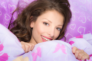 romantic beautifull girl smiling in bed
