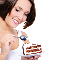 Pretty young woman eats a sweet cake