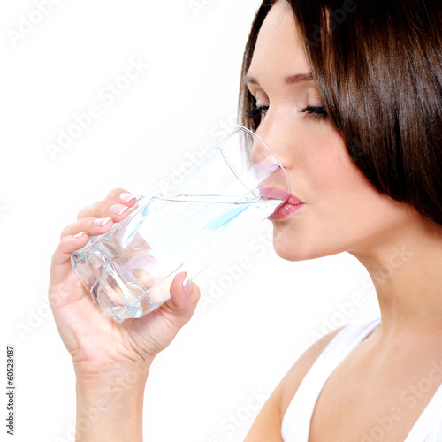 Young smiling woman holds glass of water