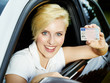 Woman shows her driver licence