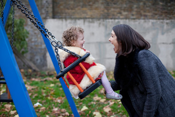 mother and child having fun in the playground