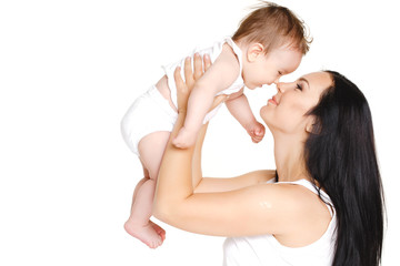 Portrait of mother and baby kissing, laughing and hugging
