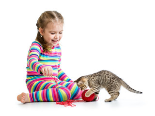 smiling kid playing with kitten