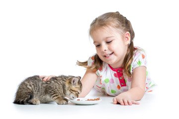 happy child feeding kitten