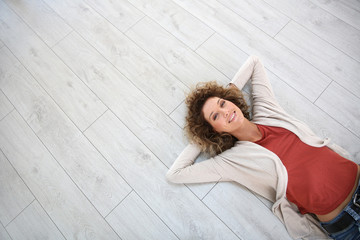 Woman laying on wooden modern flooring