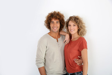 Attractive couple standing on white background