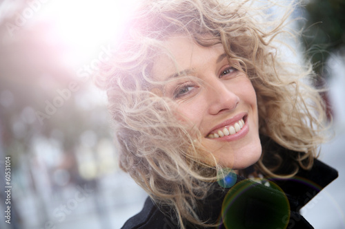 Smiling attractive woman in town in winter time