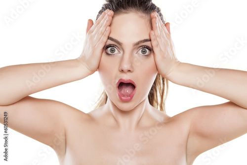 shocked beautiful girl posing on a white background