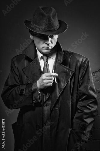 Leinwandbild Motiv Detective smokes