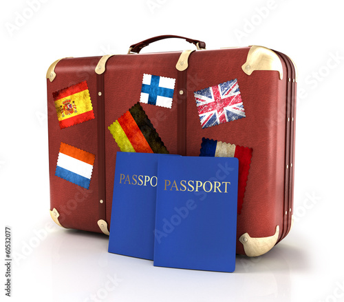 old suitcase with passports and striples flags on white backgrou