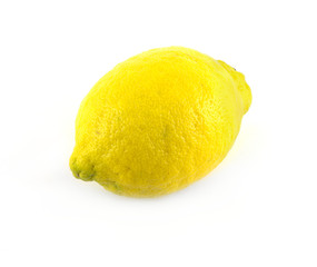 Ripe yellow lemon side view isolated diagonal view closeup