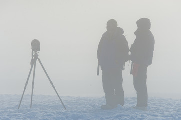 Photographers in the fog
