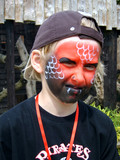 Boy with face painted as a snake