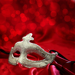 Vintage venetian carnival mask on red background