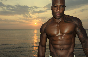 Strong man with perfect abs, shoulders,biceps, triceps and chest