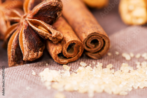 Star anise brown sugar with cinnamon at christmas time on cloth