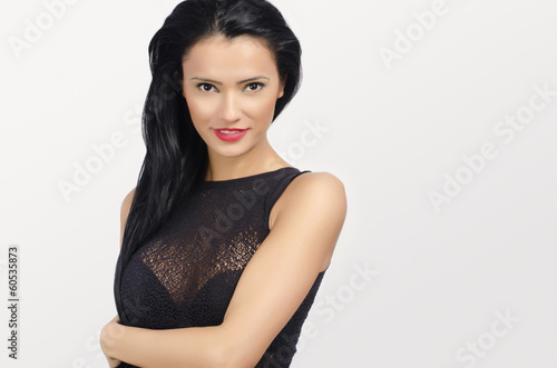 Brunette woman with big breast and red lips posing sexy