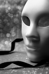 White mask with glittering background