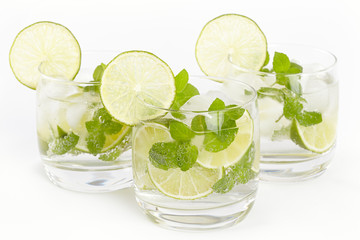 Three glasses with Mojito cocktail