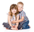 brother hugging little sister . isolated on white background