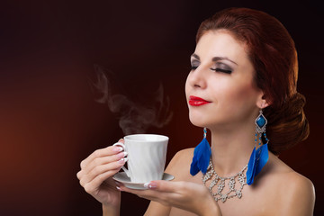Beautiful Girl drinks aromatic Coffee. Natural Coffee