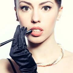 Beautiful model with a cigarette holder. Perfect skin & make-up