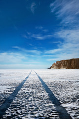 Blue sky above the road on the ice of Lake