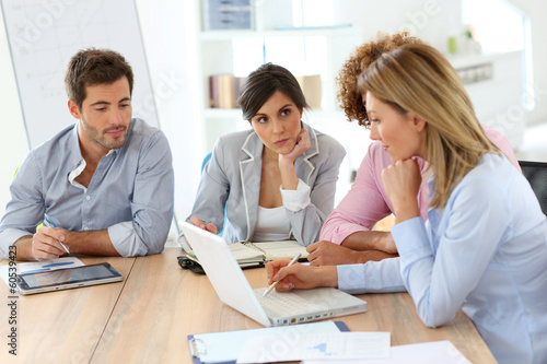 canvas print picture Young business people in a meeting