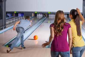 Bowling. Bowling. Friends having fun while bowling.