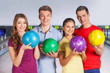 Group of people bowling.