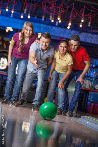Group of friends bowling.