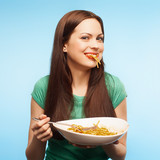 girl eats pasta. isolated