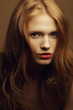 Emotive portrait of a fashionable model with red wavy hair