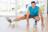 Portrait of a sporty man doing stretching exercise