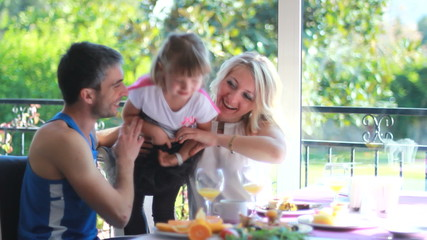 happy parents and their daughter in the kitchen
