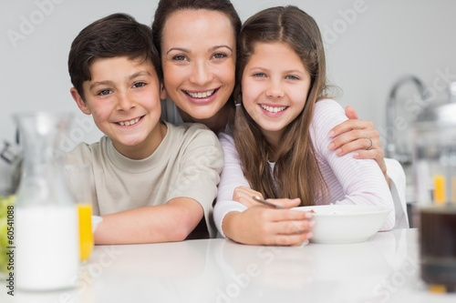 Closeup of a smiling mother with young in kitchen