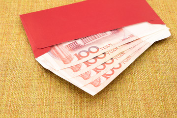 yuan banknote and red envelope