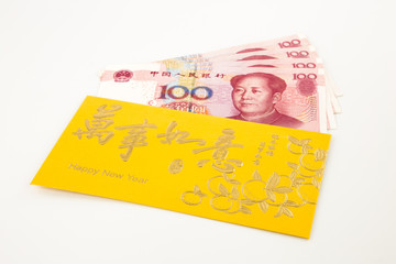 yuan banknote and golden envelope