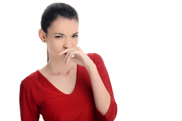 Girl holding her nose smelling something bad.Dissgusting odor