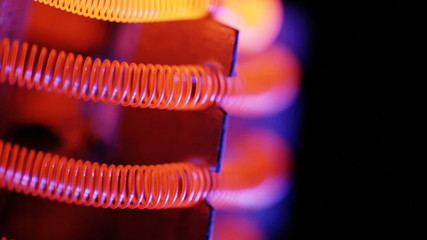 Hot tungsten filament of electric heater.