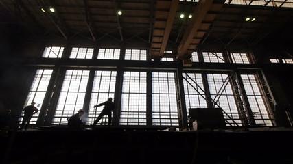 Workers in Metal Factory.